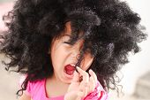 stock photo of afro hair  - Portrait of the beautiful little asian girl - JPG