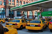 Taxis At A Gas Station