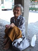 Old lady in Bangkok, Thailand.