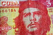 Che Guevara On Yellow Red Banknotes Of Cuba Bank. Texture Of Old Note Of The Official Cuban Currency poster