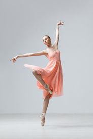image of ballet dancer  - cute young and beautiful ballet dancer jumping - JPG