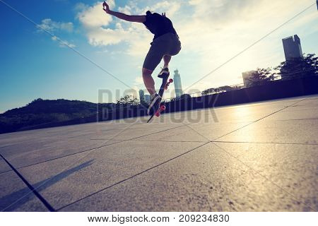 young woman skateboarder