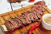 Постер, плакат: Gourmet Grill Restaurant Beef Steak Menu Skirt Steak on Wooden Plate Black Angus Beef Steak Beef