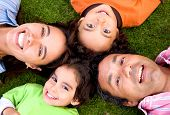 stock photo of family fun  - happy family portrait outdoors where they all look happy and smiling - JPG