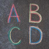Alphabet Letters Drawn On Asphalt With Chalk, A, B, C, D