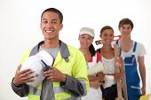 stock photo of blue-collar-worker  - group of workers smiling - JPG