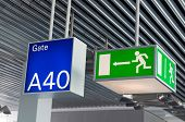 Green emergency exit sign and blue gate sign