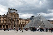 Queue of visitors to the pyramid - main entrance to the Louvre