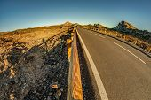 Fish Eye Lens Shot Of Sunset Time Above The Clouds In The Mountains. Fresh Lava Fields. Park Road Th poster