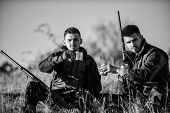 Hunters Satisfied With Catch Drink Warming Beverage. Rest For Real Men Concept. Hunters With Rifles  poster