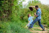 Little Helper In Garden. Cute Child In Nature Having Fun Cowboy Dad. Find Treasures. Little Boy And  poster