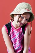 Shy Girl With A Hat