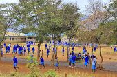Unidentified children play in school yard