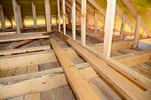 Roofing Construction Attic Insulation Interior. Wooden Roof Beams, Roof Truuses,  Frame House Attic  poster