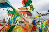 Buddhist Prayer Flags Darding With Mantras Inscribed On Them, Sutras And Prayers. poster