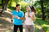 Happy Couple Jogging And Running Outdoors In Nature poster