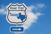 Texas Road Trip Highway Sign, Texas Map And Text Road Trip On A Highway Sign With Sky Background 3d  poster