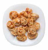 Dumplings On A White  Plate Isolated On White Background. Dumplings In Tomato Sauce. Dumplings Top V poster