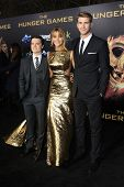 LOS ANGELES, CA - MARCH 12: Josh Hutcherson, Jennifer Lawrence, Liam Hemsworth at the premiere of Li