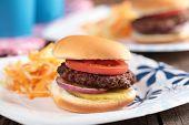 Mini hamburgers with coleslaw on paper plates