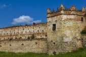 Medieval Citadel. Ruins Of Stare Selo Castle, Wall Close-up Against The Blue Cloudy Sky. Fortress In poster