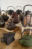 A collection of antique Asian teapots