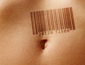 Close up  stomach of woman with barcode