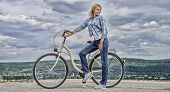 Woman Rides Bicycle Sky Background. Benefits Of Cycling Every Day. Keep Fit Shape Easy With Regular  poster
