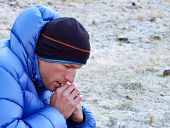Close Up Of A Concentrated And Pensive Mountain Climber In Thick Down Jacket Lost In Thought And Loo poster