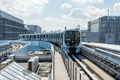 The Monorail Train Is Approaching Station On A Sunny Day. The White Metro Train Is Arriving To The P poster