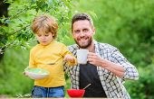 Little Boy And Dad Eating. Nutrition Kids And Adults. Healthy Nutrition Concept. Menu For Children.  poster