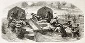 French soldiers carrying a cannon on two paired boats  (Cochinchina campaign). Created by Worms, pub