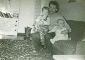 Vintage photo of father with sons (early eighties)