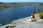 Young Woman Enjoying The View Over Lake