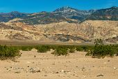 Sand Dunes In A Desert Landscape In Death Valley California.  The Vast Barren Land Is Dry And Arid D poster