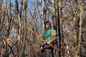 stock photo of longbow  - man with traditional longbow in a winter shot - JPG