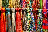 pic of stall  - Rows of colourful silk scarfs hanging at a market stall in Istanbul - JPG