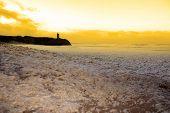 Sweeping Waves Of Foam Crashing On Ballybunion Beach
