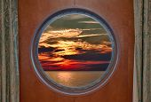 Dramatic Sunset Seen Through A Ship Porthole