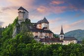 stock photo of wall cloud  - Beautiful Slovakia castle at sunset  - JPG