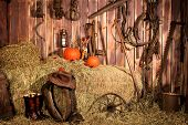 stock photo of horse plowing  - Interior of old barn full of vintage tools and horse plow equipment - JPG