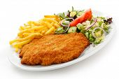 stock photo of pork cutlet  - Fried pork chop French fries and vegetables - JPG