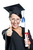 Graduating student with the certificate and in the black academic gown thumbs up, isolated on white