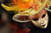 stock photo of venice carnival  - Vintage carnival mask in front of lights background - JPG