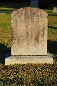 stock photo of tombstone  - Blank Tombstone in a cemetery ready for text - JPG