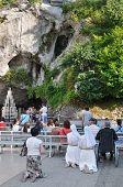 Believers Near The Grotto In Lourdes