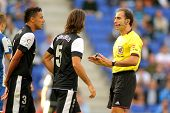 BARCELONA - OCT, 27: Demichelis and Welington of Malaga discuss with the referee Delgado Ferreiro du