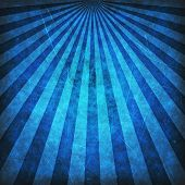 Blue grunge sunbeams background or texture