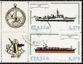 ITALY �?�¢?? CIRCA 1978: a block of two stamps printed in Italy shows illustrations of  container ship, frigate and old sextant and compass. Italy, circa 1978