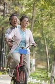 Older couple riding tandem bicycle, Beijing